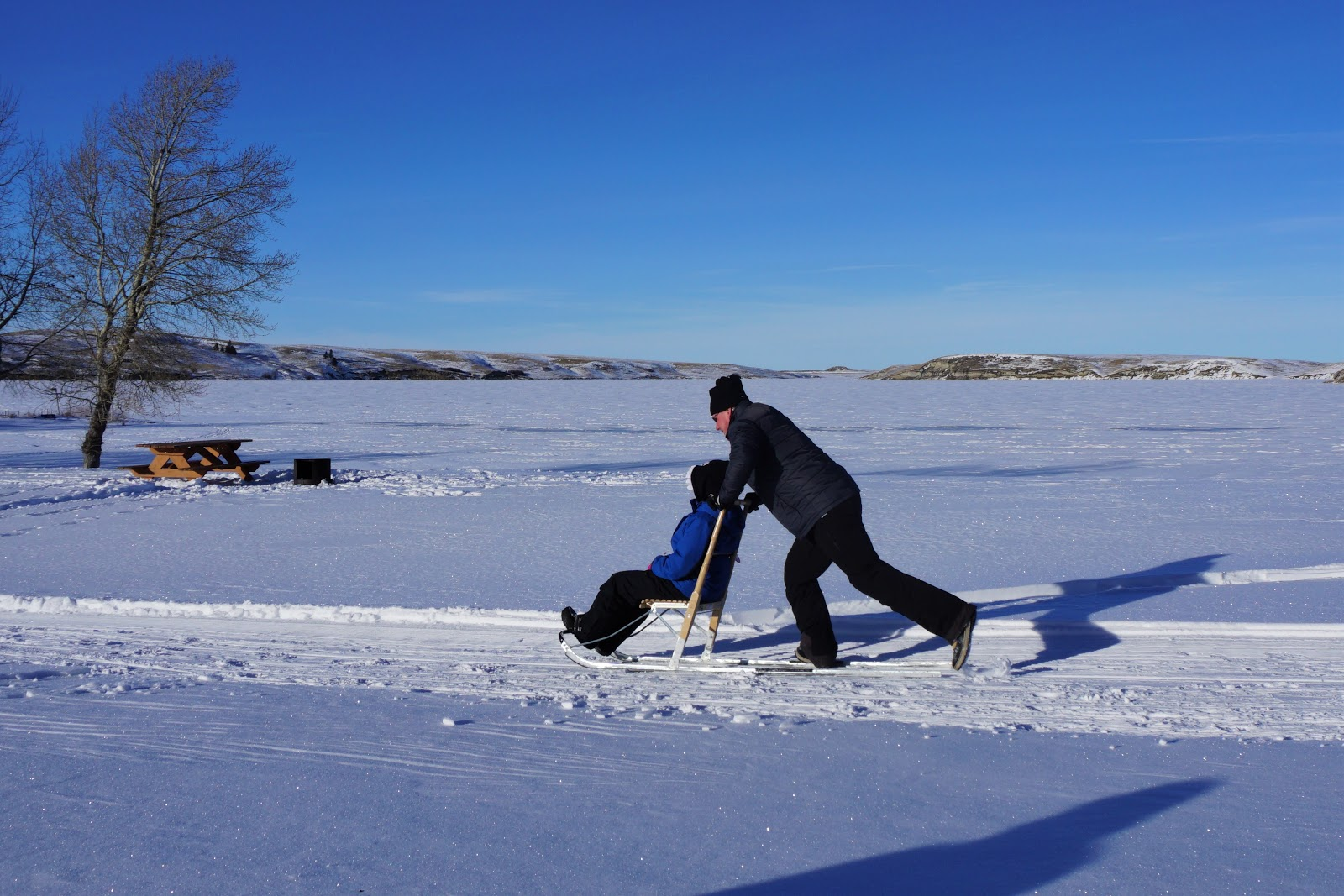 Kicksledding at Elkwater Lake, Cypress Hills Provincial Park