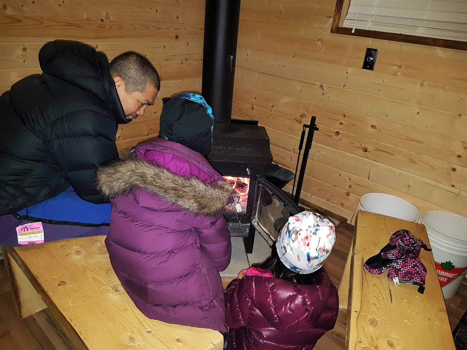 Warming up by the fire at Reesor Lake Backcountry Hut