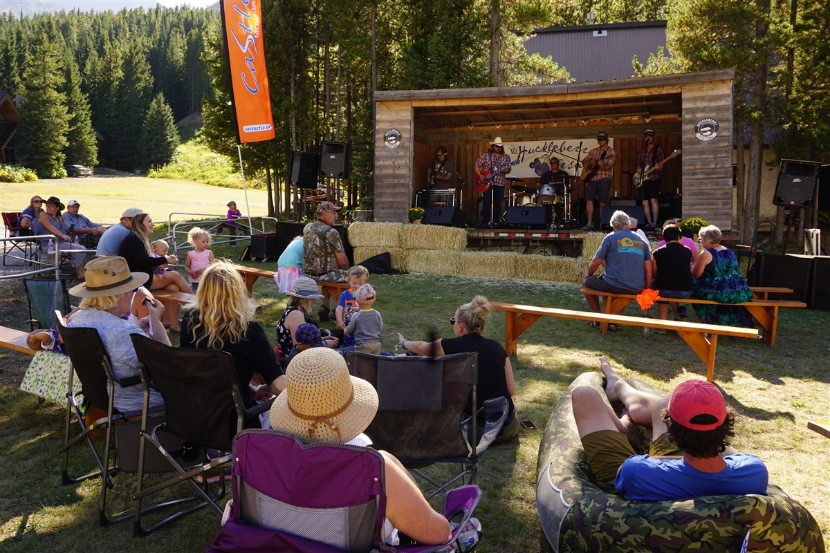 Live music on the Huckleberry Stage, Castle Mountain Resort
