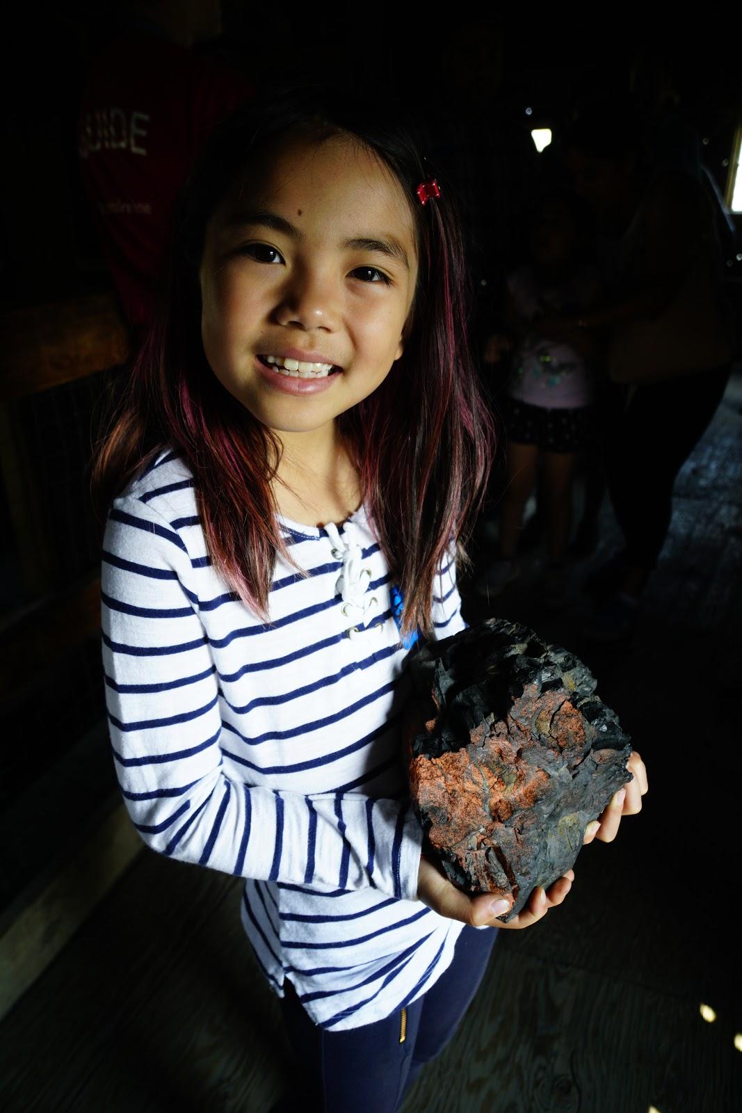 Miya holds a big lump of Wildfire coal.